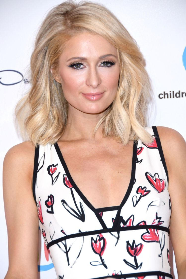 Paris Hilton Looks Cool At Oscar De La Renta Spring Luncheon